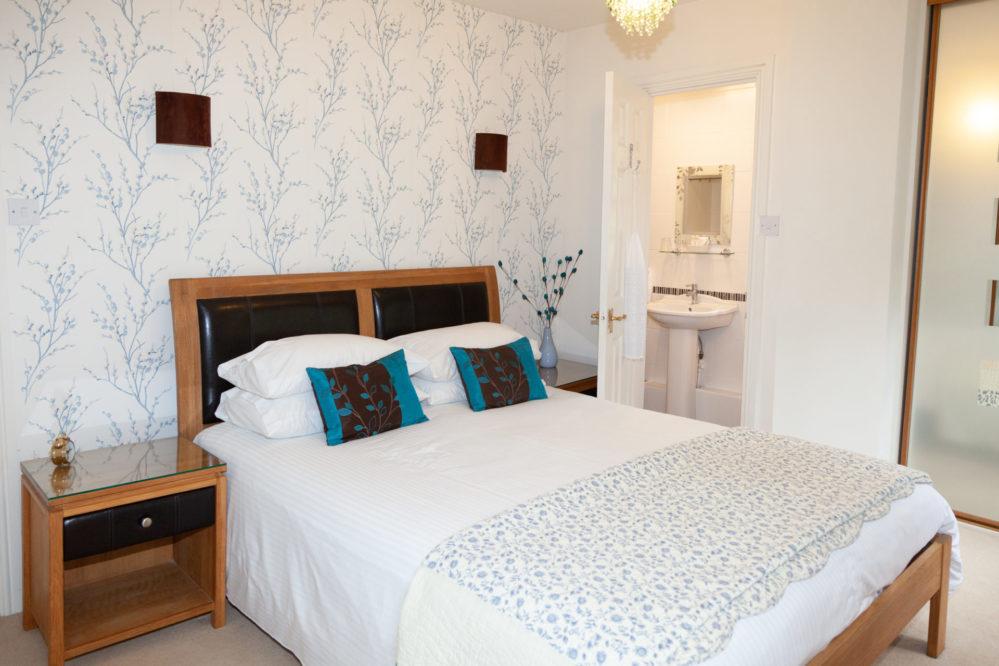 Mallock Cottage bedroom at Cockington Cottages
