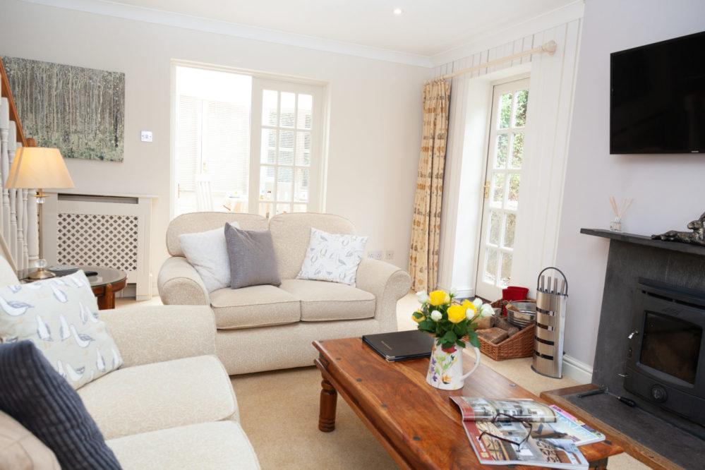 Mallock Cottage lounge at Cockington Cottages